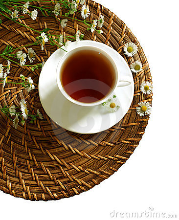 Cup of tea and chamomiles isolated on white