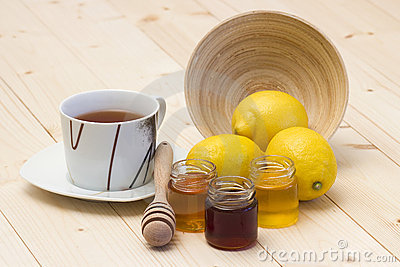 Cup of tea, fresh lemons and honey