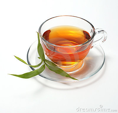 Cup with tea and leaf