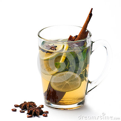 Cup of tea with lemon, anise star and cinnamon