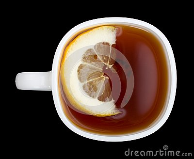 Cup of tea with lemon on black view from above