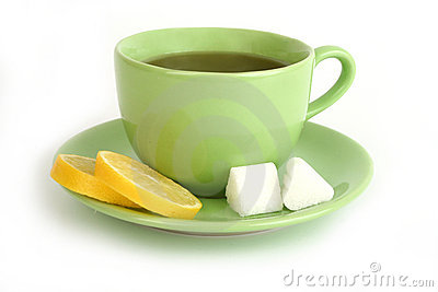 Cup of tea with lemons and lumps of sugar