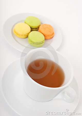 Cup of tea and macarons for dessert