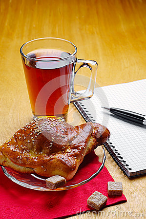 Cup of tea and notepad