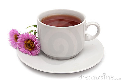 Cup of tea and pink daisies.