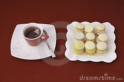 Cup of tea and stacked and aligned macaroons