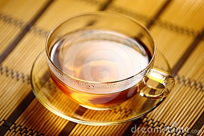 Cup of tea on straw tablecloth