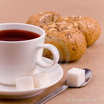 Cup of tea, sugar and bread