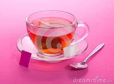 Cup of tea and sugar on a saucer