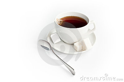 Cup of tea with sugar and teabag isolated on white