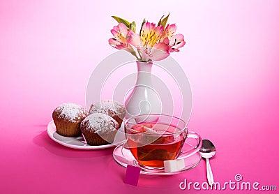 Cup of tea, teaspoon and cupcakes