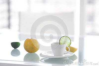 Cup of tea with tropical fruits