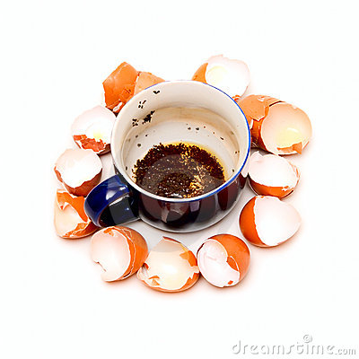 Cup with weak tea and shells