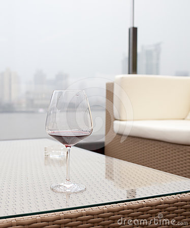 Cup of wine in front of  huangpu river