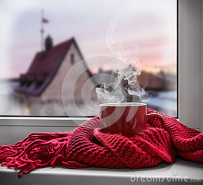 Free Cup With A Hot Drink On The Windowsill Royalty Free Stock Image - 58925836