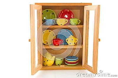 Cupboard With Cheerful Crockery Stock Image Image 16556671