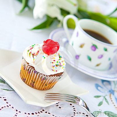Cupcake with a cup of coffee