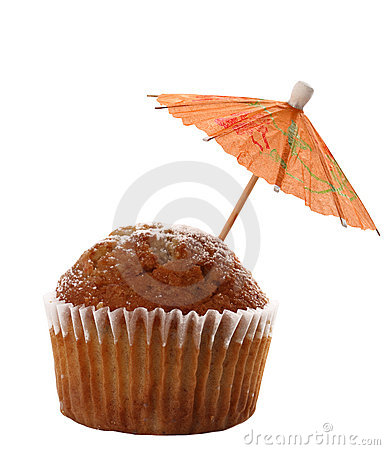 Cupcake muffin with red cocktail parasol