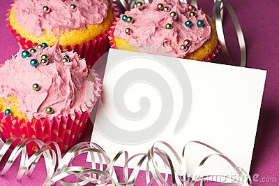 Cupcakes with a blank invitation