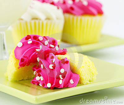 Cupcakes with Pink Icing and a Glass of Milk