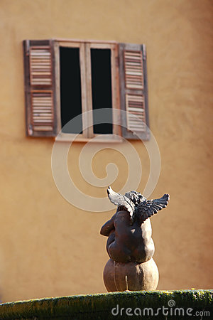 Free Cupid Sitting In Front Of Window Royalty Free Stock Image - 26231206