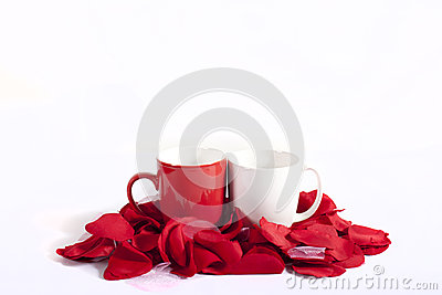 Cups on red rose petals