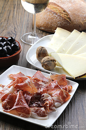 Cured iberian ham and cheese tapas