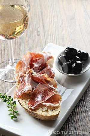 Cured iberian ham and olives tapas
