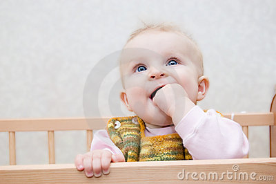 Curious baby with finger in mouth