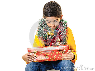 Curious boy with Christmas presents
