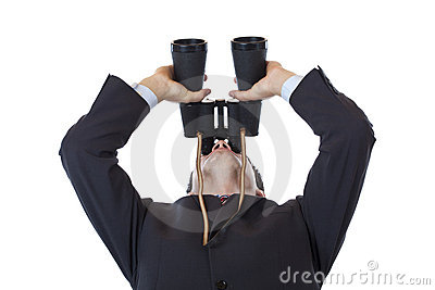 Curious businessman turns binoculars up to the sky