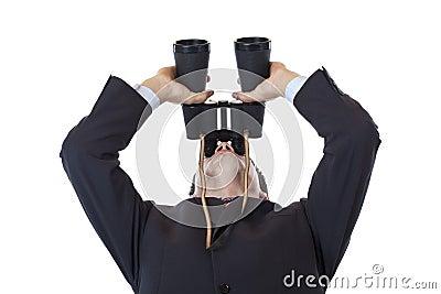 Curious businessman turns binoculars up to the sky