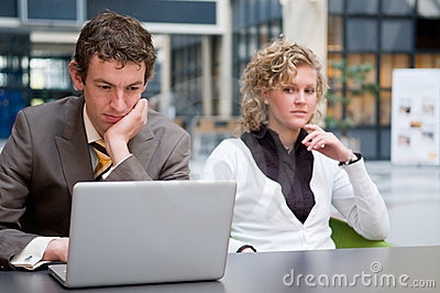 Curious Businesswoman Looking At Her Colleague