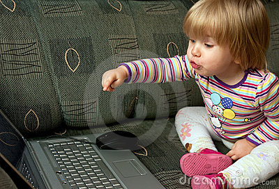 Curious child with computer