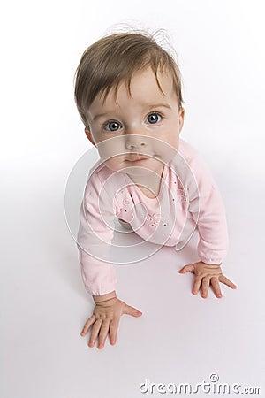 Curious crawling baby girl