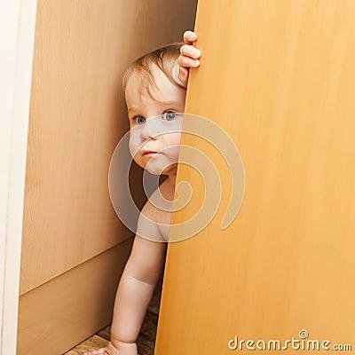 Free Curious Cute Baby Boy Looking Through Ajar Door Royalty Free Stock Images - 51976329