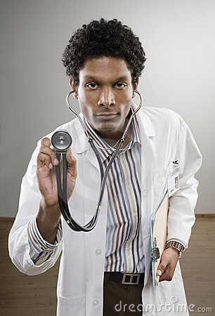 Curious doctor in lab coat holding stethoscope