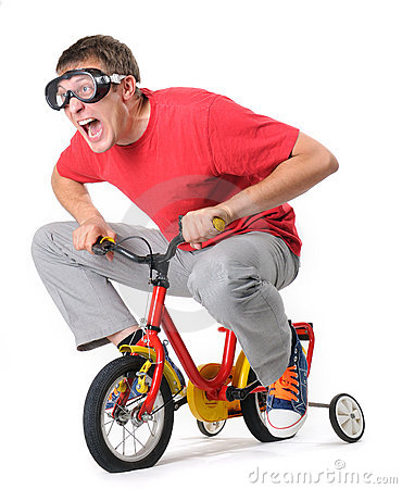 Curious man in goggles on a children s bicycle