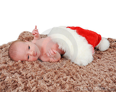 Curious newborn laying in Santa hat on blanket