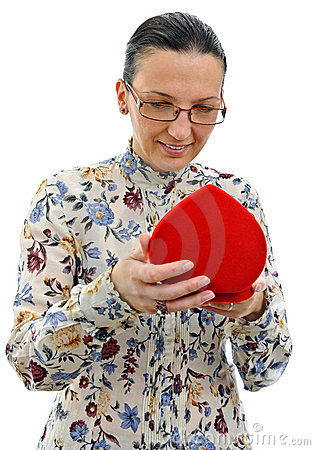 Curious woman looking at gift in red heart box
