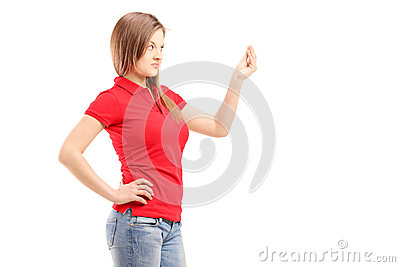 Curious young woman gesturing with hand