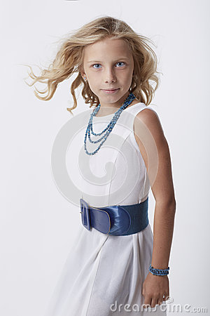 Curly blonde little girl in white dress
