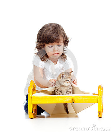 Curly child girl playing with kitten