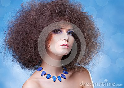 Curly hair and blue make-up