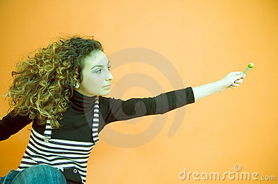 Curly Haired Girl Giving a Lollipop