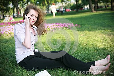 Curly-haired girl with the phone sitting