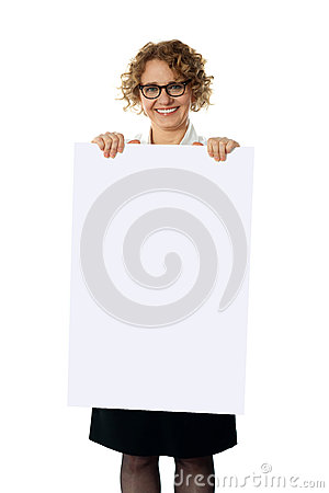 Curly haired woman holding advertising board
