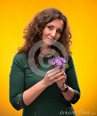 Curly woman with crocus flowers