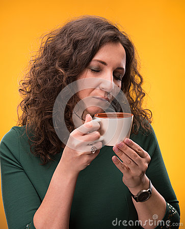 Curly woman with a cup of tea or coffee