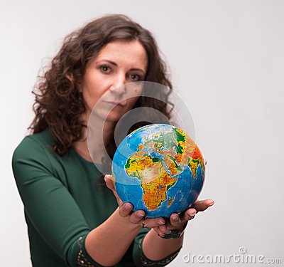 Curly woman holding a globe